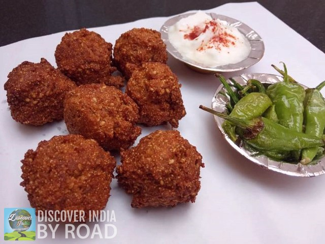 Dakor's famous food item Gota with fried green chilies.
