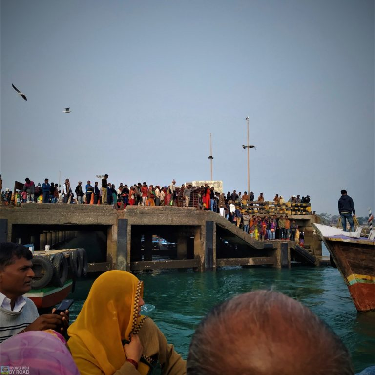 Passengers waiting for boat at jetty