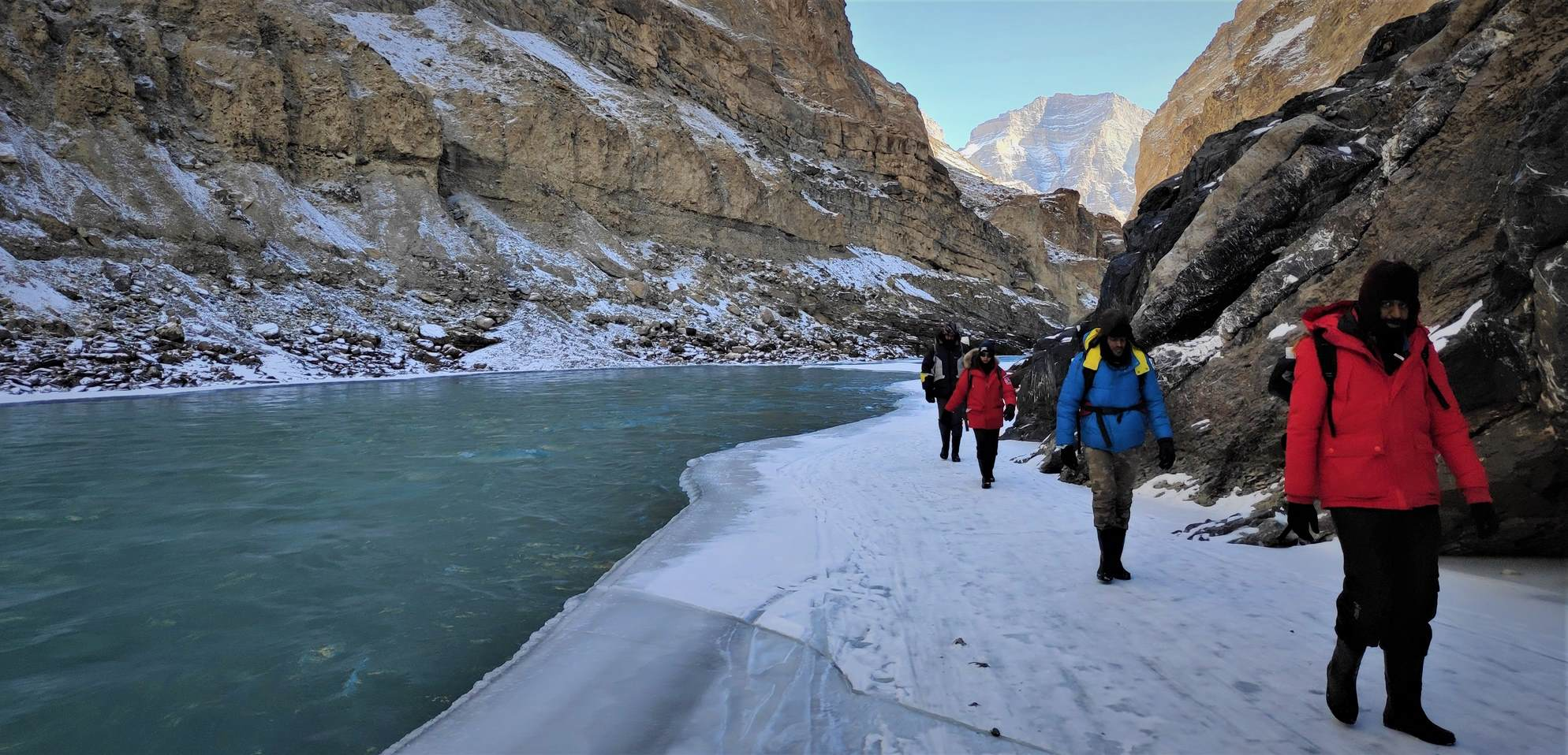 People trekking on Chadar trek on Frozan Zanskar River
