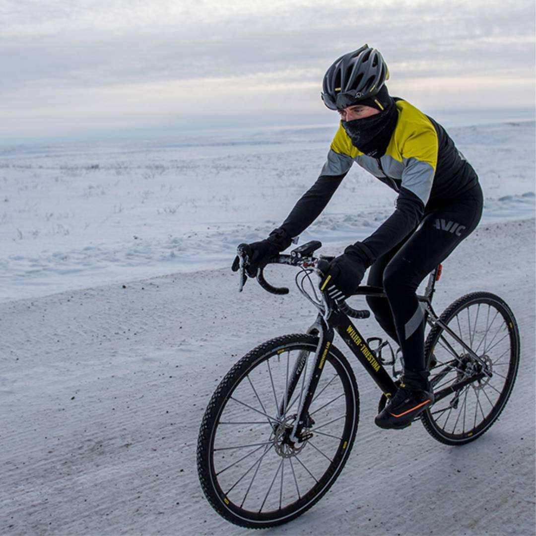 Man doing Regular Cycling on beach
