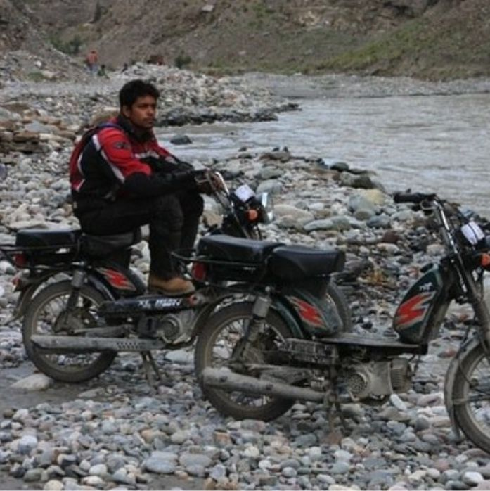 rider sitting on Moped in Leh