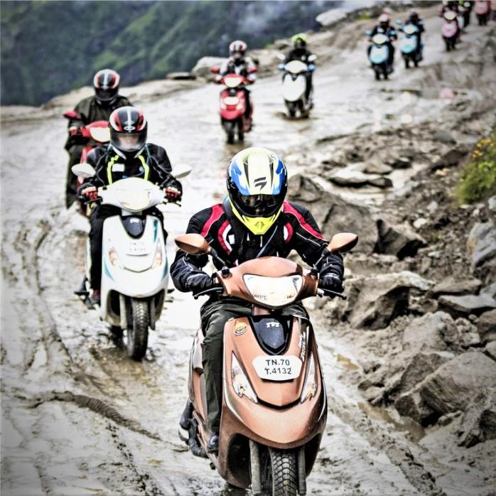 Goupe of Scooty riders on muddy roads Ladakh